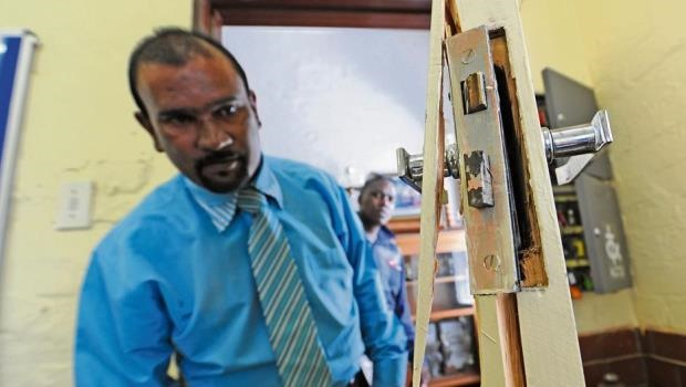 Mountain Rise Primary School principal Vasu Soobrayan and governing body member Themba Malinga inspect the damage after thieves broke into the school on Sunday night