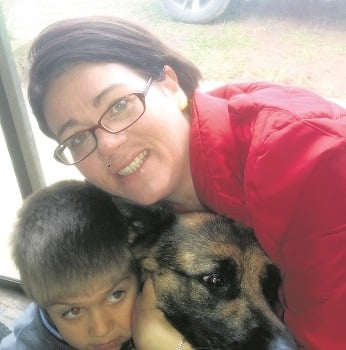 Celeste and Nathan van Wyk (5) happily reunited with their German Shepherd, Lady, who went missing a year ago and was found through a Facebook lost and found page.