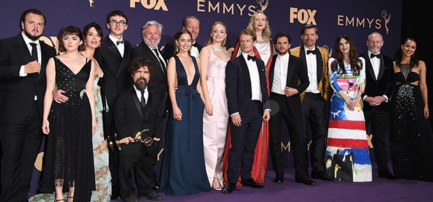 The cast of 'Game of Thrones'  pose with the Emmy for Outstanding Drama Series. (AFP)