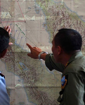 Indonesian Air Force officials at Medan city military base plot the Indonesian military search operation for the missing Malaysian Airlines flight MH370 in the area of Malacca Strait. (File, AFP)