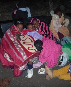 """Congregants of the End Times Disciples Ministries try to keep warm after the 'prophet' supposedly lowers the temperature. (<a href=""""https://www.facebook.com/pages/End-Times-Disciples-Ministries/351175848381100?sk=timeline"""" target=""""_blank"""">End Times D"""