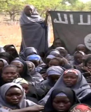 A screengrab taken from a video released by Nigerian Islamist extremist group Boko Haram obtained by AFP shows girls wearing the full-length hijab. (AFP)