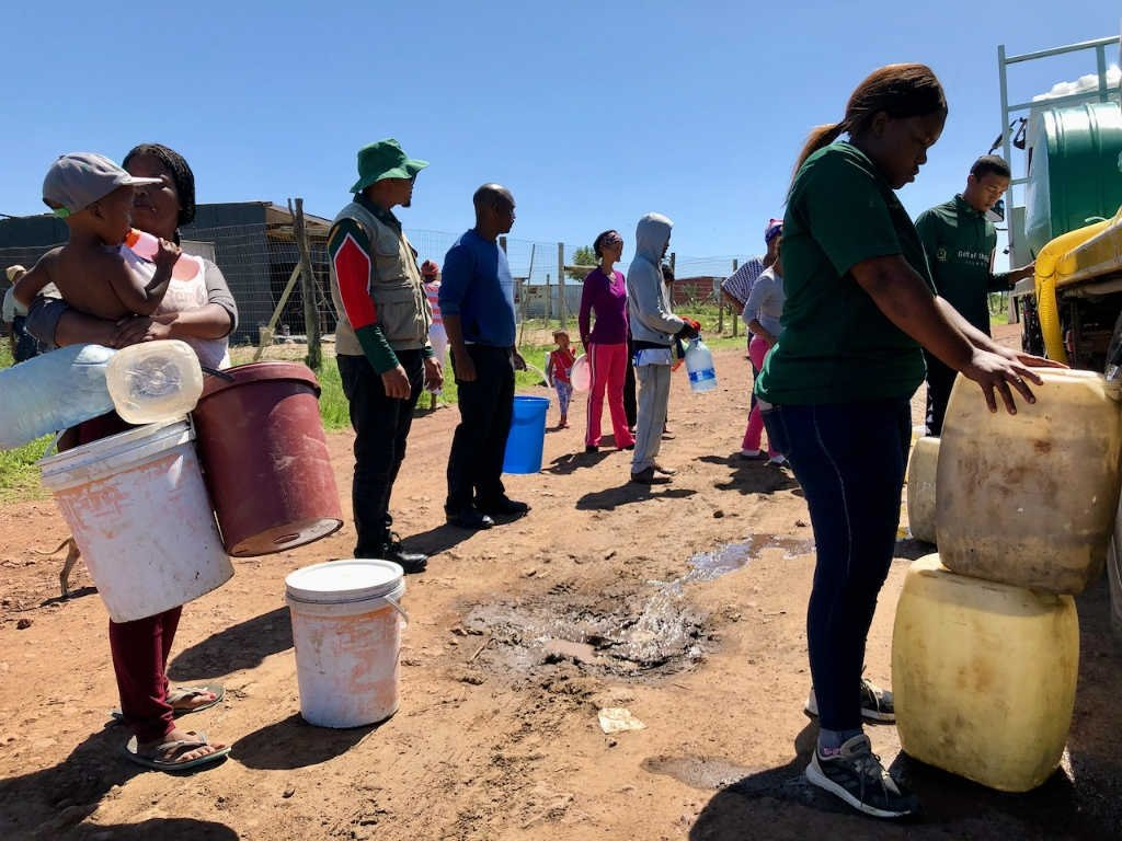 Makhanda residents collect water from a Gift of the Givers water tanker in March last year.