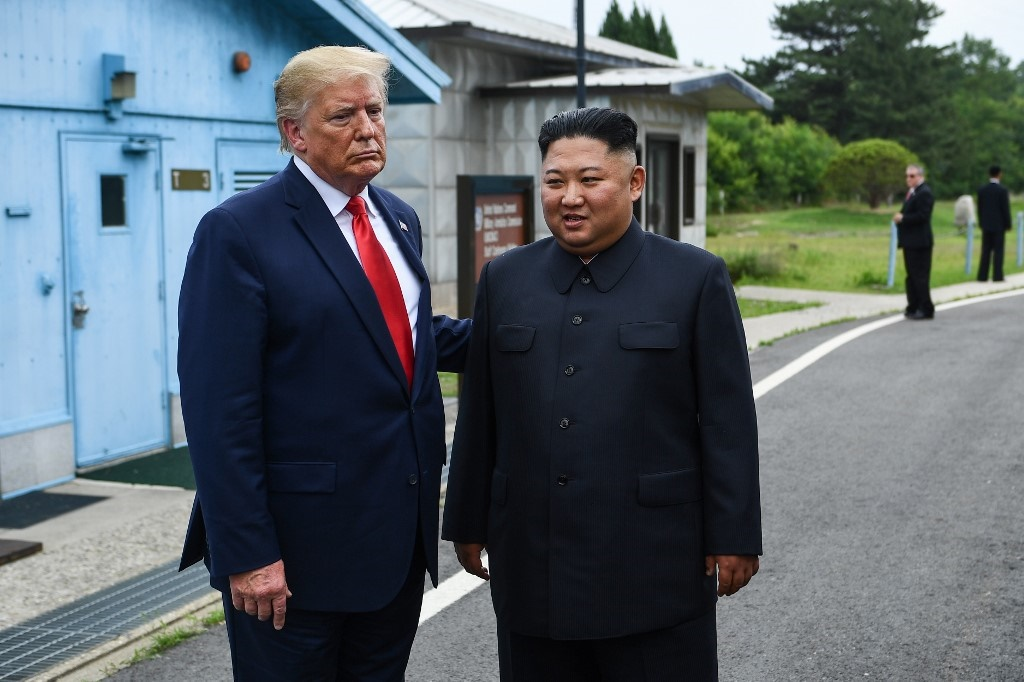 North Korea's leader Kim Jong Un stands with US President Donald Trump south of the Military Demarcation Line that divides North and South Korea. (Brendan Smialowski / AFP)