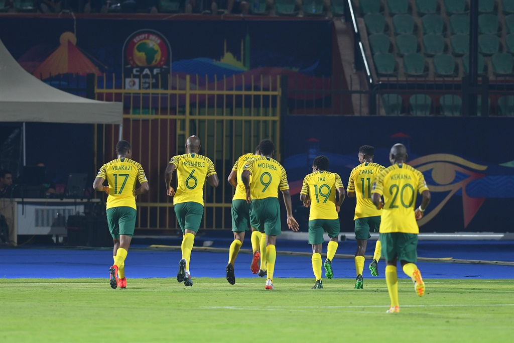 Bafana players celebrate after the only goal in their late night win over Namibia at Al-Salam Stadium in Cairo. Picture: Ahmed Hasan/Gallo Images