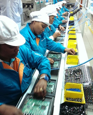 Hisense workers place components on boards in the flat screen TV production process at the factory in Atlantis. (Duncan Alfreds, News24)