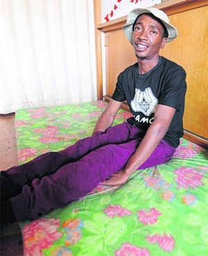 Thokozani Mbele shows the mattress he has been sleeping on in an empty room. Mbele is one of the adults who is part of the Adults Living in the Street project headed by the city. (The Witness)