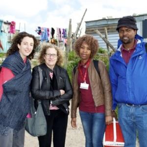 Senior Technical Advisors from the Office of the US Global AIDS Coordinator (PEPFAR), Julia MacKenzie and Nancy Padian, accompany Community HIV Care Providers, Amanda Kili and Patrick Matshoba, on a home visit in Cape Town