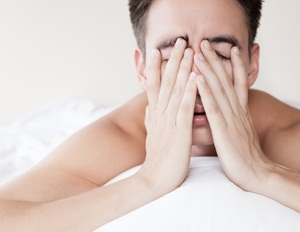 Man with lack of sleep from Shutterstock