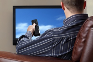 Man watching tv from Shutterstock
