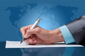 Businessman signing contract from Shutterstock