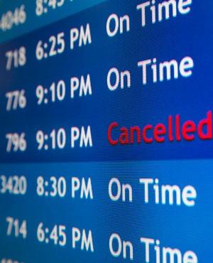 A departure board at the Philadelphia International Airport shows that US Airways Flight 796 to Tel Aviv has been cancelled.  (Matt Rourke, AP)