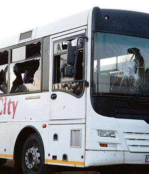 Buses were stoned as minibus taxi drivers continued to protest against the introduction of the Autopax bus service in the Mamelodi area, east of Pretoria. Three buses were damaged. PHOTO: Lucky Nxumalo