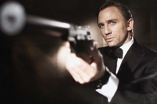 Daniel Craig poses as James Bond. (Photo: Greg Williams/Eon Productions via Getty Images)