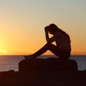 Sad-woman-during-sunset