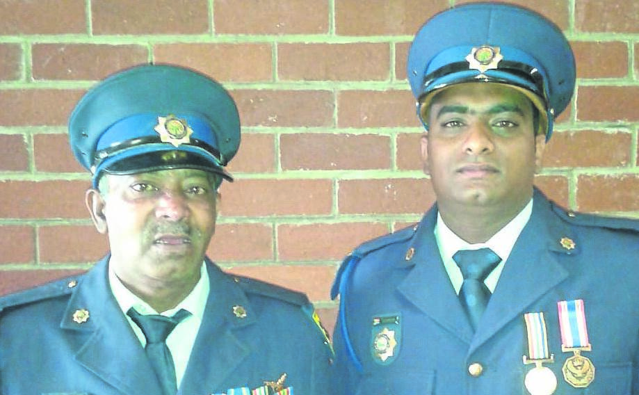 Warrant Officer Lawrence Govender (left), who passed away recently due to illness, with his son, Sergeant Dinesh Govender.PHOTO: SUPPLIED