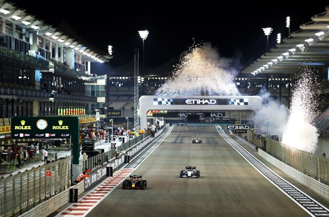 Fireworks go off as race winner Max Verstappen of the Netherlands driving the (33) Aston Martin Red Bull Racing RB16 crosses the line during the F1 Grand Prix of Abu Dhabi at Yas Marina Circuit on December 13, 2020 in Abu Dhabi, United Arab Emirates.