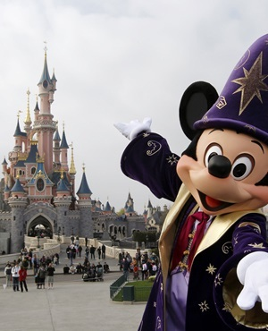 Disney character Mickey poses in front of the Sleeping Beauty Castle at Disneyland park outside Paris. (Thomas Samson, AFP)