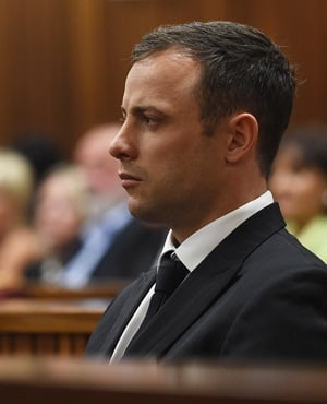 Oscar Pistorius listens as judgment is handed down in his murder trial. (Phill Magakoe/Independent Newspapers/ Pool)