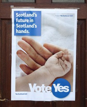 A pro-independence poster is pictured on the door of a property in the town of Selkirk on the Scottish side of the border between England and Scotland. (Lesley Martin, AFP)
