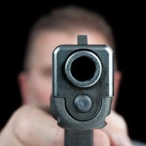Man pointing gun from Shutterstock
