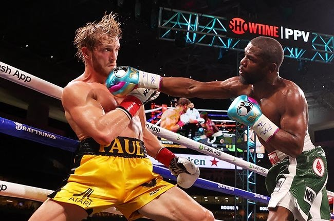 Logan Paul and Floyd Mayweather. (Photo by Cliff Hawkins/Getty Images)