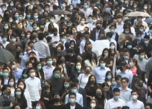 Hong Kong activists vow to 'squeeze economy' as city smoulders