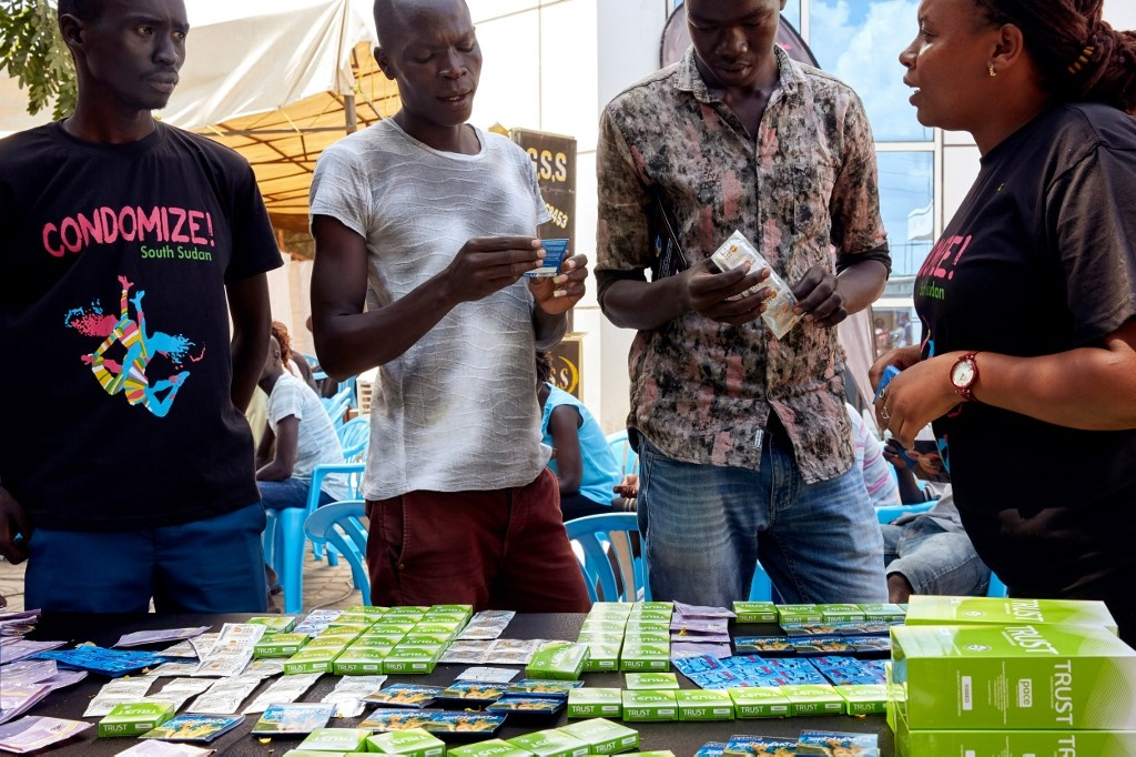 University students browse through a selection of different types of condom during a sexual health awareness course at Kampala University in Juba, South Sudan. (Alex McBride / AFP)