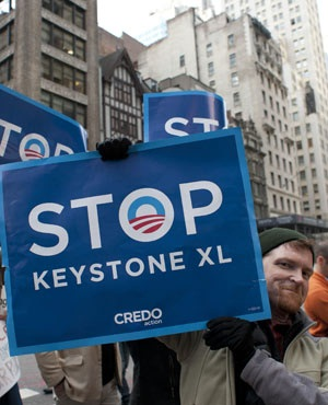 Environmental activists as they march through midtown protesting the proposed Keystone XL pipeline, in New York. (Don Emmert, AFP)
