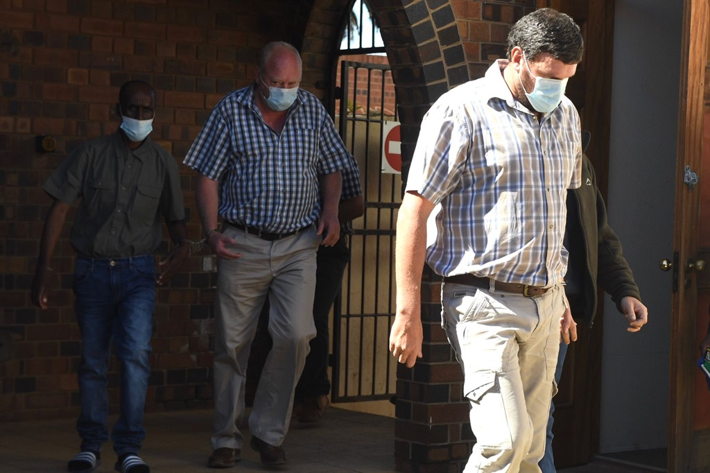 The suspects are brought into the courtroom. Photo Deaan Vivier