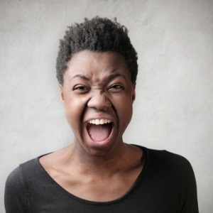 African woman screaming from Shutterstock