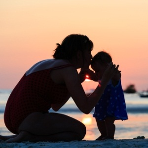 Mother and daughter on beach from Shutterstock