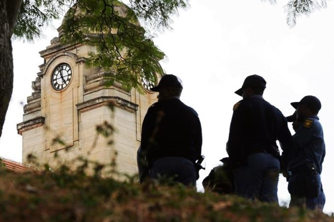 Members of the SAP keep an eye out for any protests under the clock tower of Old Main Building at UKZN  on Monday.