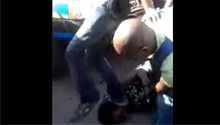 WATCH: Grandmother's head trampled in police scuffle