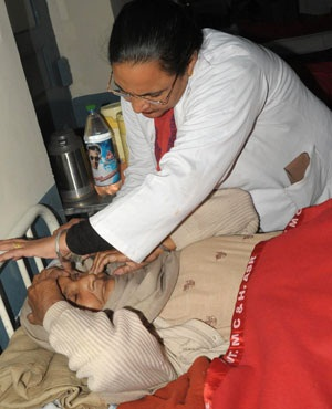An Indian medical personel puts drops into the eye of patient Sampuran Kaur. (AFP)