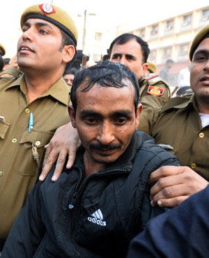 Indian police escort Uber taxi driver and accused rapist Shiv Kumar Yadav following his court appearance in New Delhi. (Chandan Khanna, AFP)
