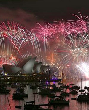 Fireworks explode over the Opera House and the Harbour Bridge during New Years Eve celebrations in Sydney, Australia. (Rob Griffith, AP)