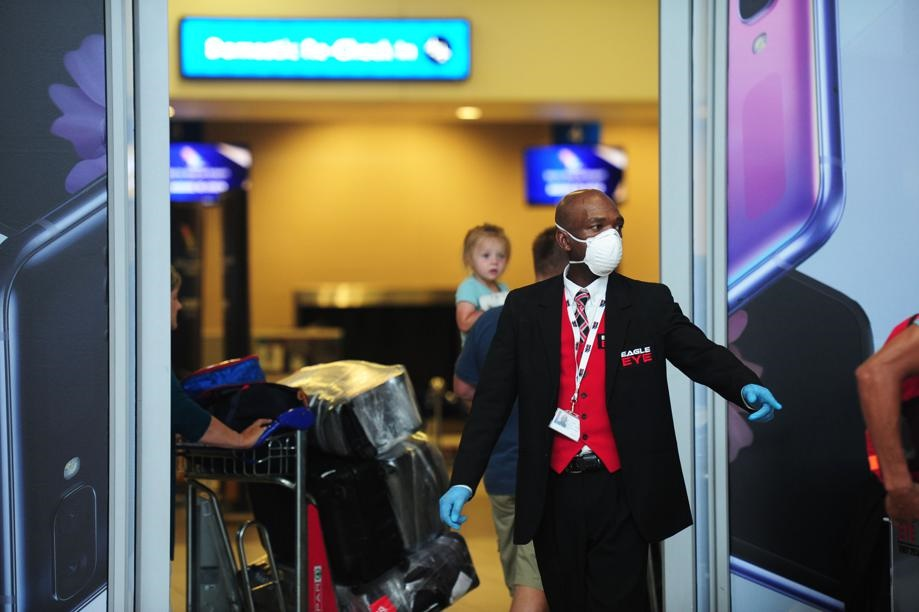 OR Tambo International Airport employees are seen covered in masks to protect themselves from Covid-19. Picture: Cebile Ntuli/City Press