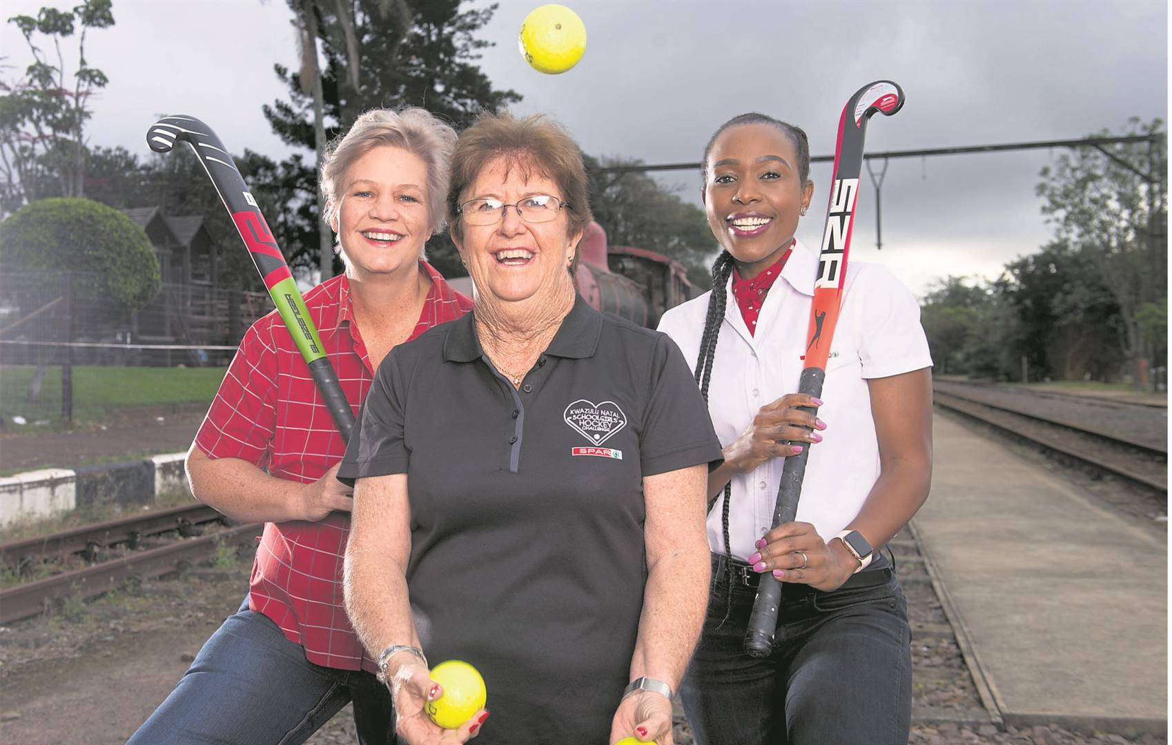 photo: val adamsonBack on track after juggling schedules and Covid-19 regulations, the SPAR KZN Schoolgirls' Hockey Challenge kicks off on the first weekend of May. Celebrating the announcement are Claire Hogg, Sponsorships Controller from SPAR KZN, Tournament Director Les Galloway from Schoolgirls Sports and Nozi Mkhize, Advertising and Sponsorship Manager for SPAR KZN.