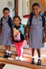 Sisters Ayesha and Zahra Schroeder hold their cousin Aliyah Schroeder's hand on her first day of preschool