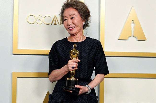 """Yuh-Jung Youn, winner of the award Actress in a Supporting Role for """"Minari,"""" poses in the press room at the Oscars."""