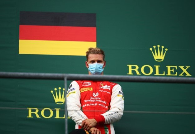 Third placed Mick Schumacher stands on the podium after the feature race of the Formula 2 Championship at Circuit de Spa-Francorchamps. Image: Bryn Lennon / Getty.