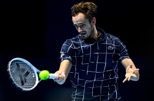 Daniil Medvedev of Russia hits a forehand against Novak Djokovic of Serbia during Day 4 of the ATP Tour Finals at The O2 Arena in London on 18 November 2020.