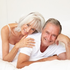 Senior couple in bed from Shutterstock