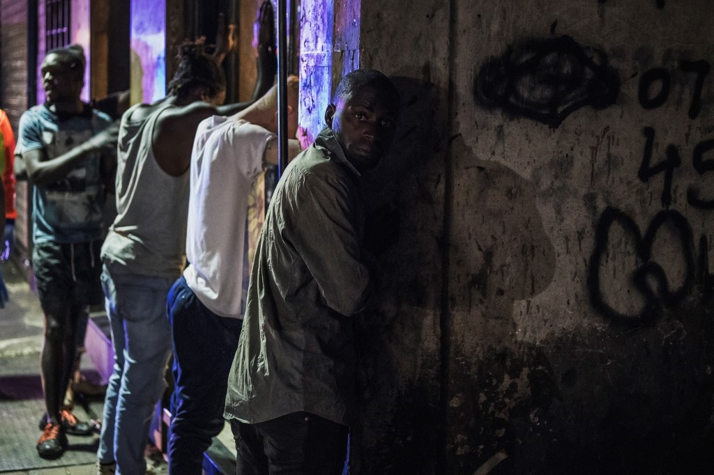 Suspects are lined up against a wall as members of the South African Police Service arrest them because they defied the lockdown order during an operation in the Johannesburg CBD.