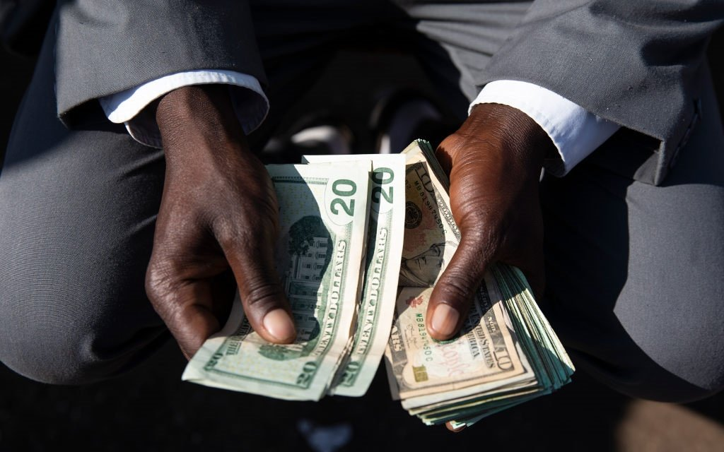 A man holds Zimbabwean Dollar Bond Notes on August 5, 2018 in Harare, Zimbabwe.