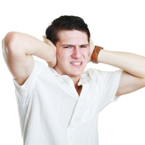Young man hearing voices from Shutterstock