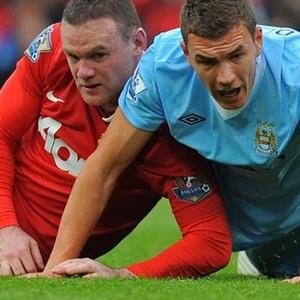 Rooney and Dzeko (AFP)