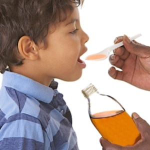 Treating a child with cough mixture