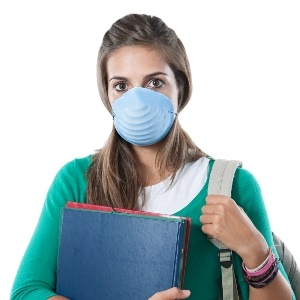 student with allergies takes precautions